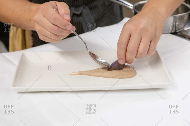 Chef preparing gourmet dish in restaurant