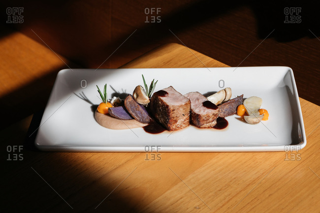 A gourmet meat and mushroom dish in restaurant