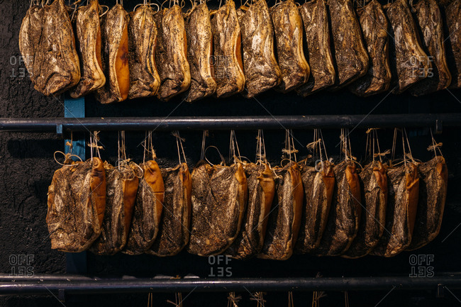 Seasoned meat hanging on racks in South Tyrol, Italy