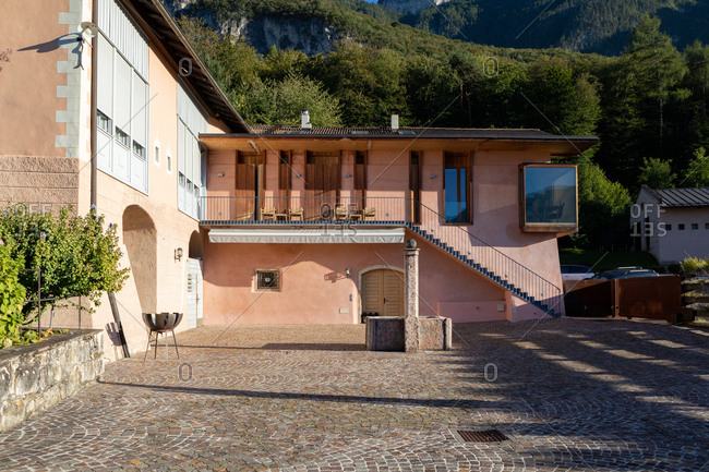 South Tyrol, Italy - September 27, 2018: Pink building exterior and courtyard