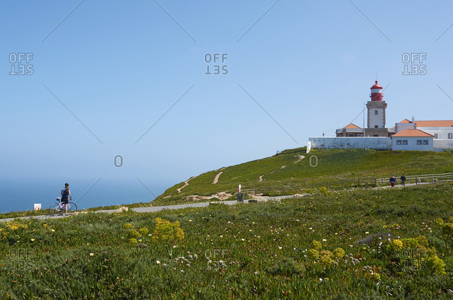 Biker at Cabo da Roca Lighthouse, Sintra, Portugal