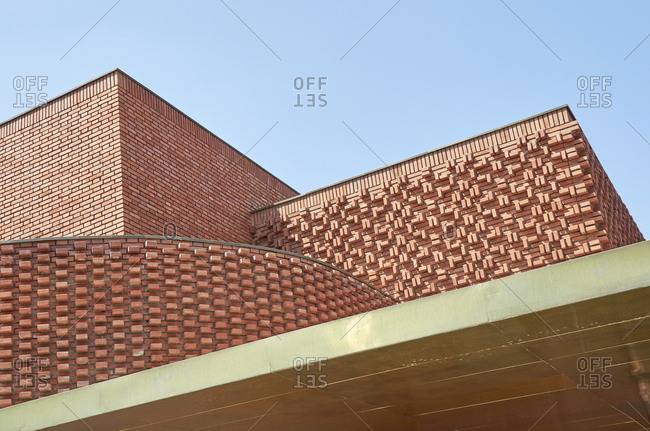 Low angle view of unique brick building in Marrakesh, Morocco, Africa