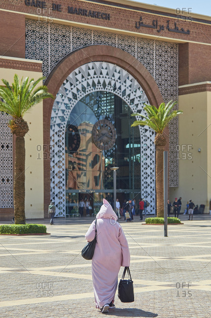 Marrakesh, Morocco, Africa - May 12, 2018: Woman walking in front of the Marrakesh railway station