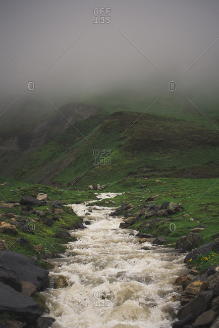 Scenic view of river flowing during foggy weather