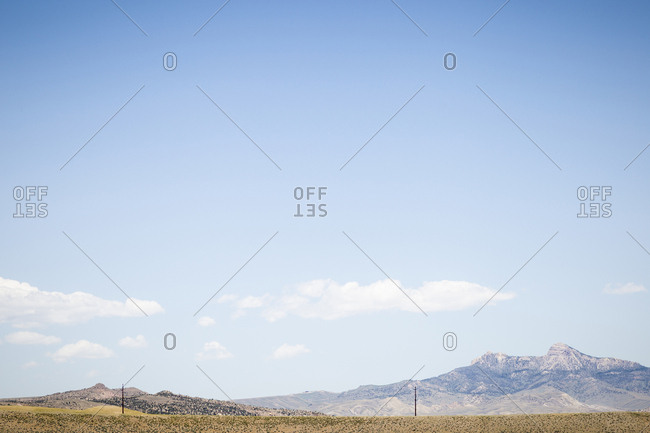 Scenic view of mountains against sky during sunny day