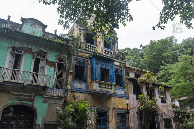 Facade of old abandoned historical houses in Largo do Botic��rio