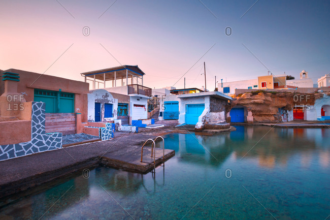 Boat houses in the harbour of Mandrakia village on the northern coast