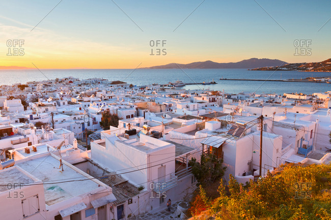 View of Mykonos town and Tinos island in the distance, Greece.