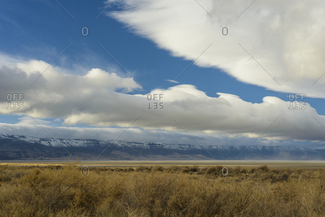 Puffy Clouds Rolling Over The Oregon Desert
