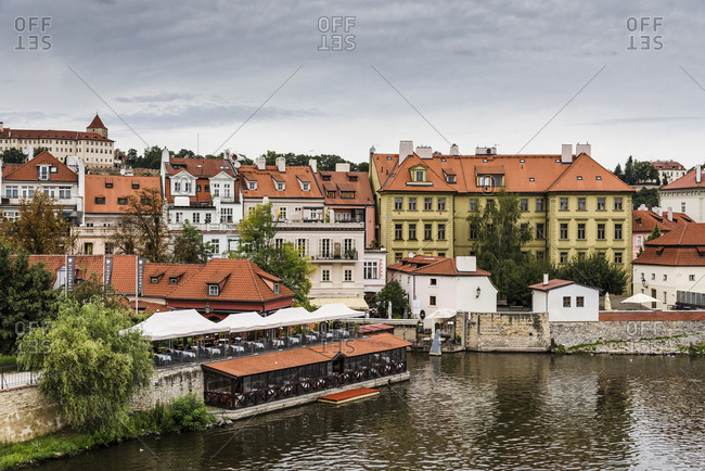 Czech Republic, Prague - August 19, 2017: High angle view of buildings by Vltava river against sky in city