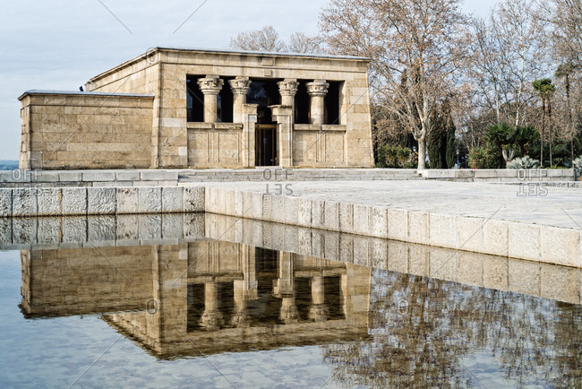 Spain, Madrid - January 13, 2018: Temple of Debod reflecting on pond against sky