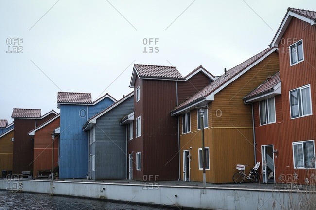 Colorful houses in row against clear sky
