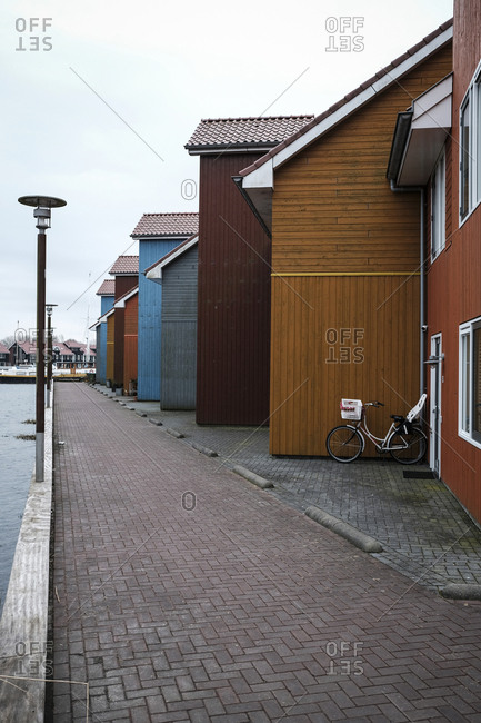 Colorful houses in row by footpath