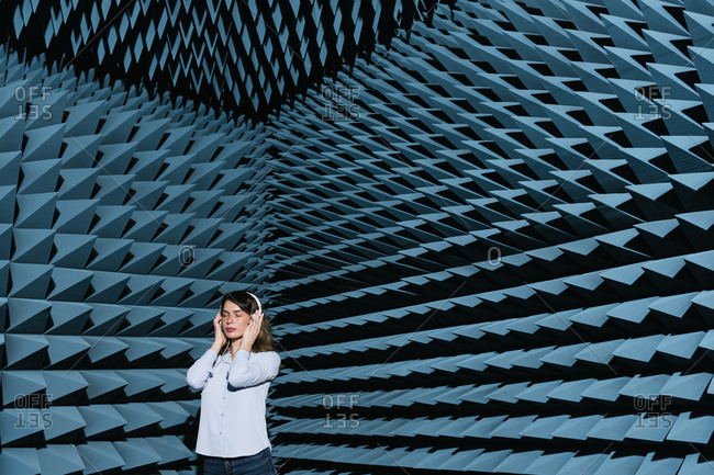 Woman in sound room listening to music