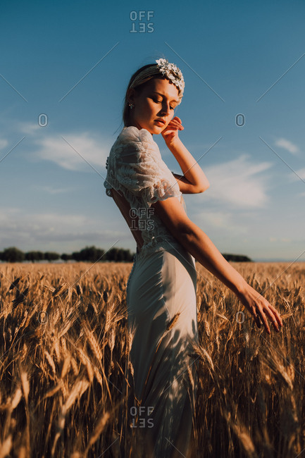 Woman in middle of wheat field