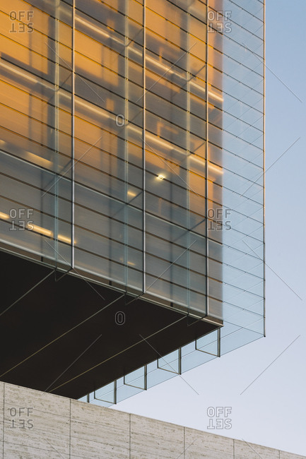 Rectangular on wall of building with dark contrast shadow in sunset light