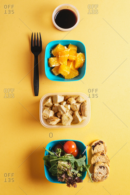 Plastic containers with healthy food and black fork