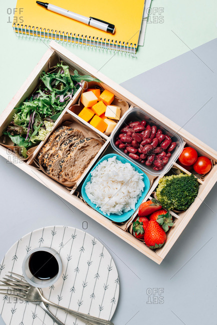 Food box with diet ingredients by copybook and plate