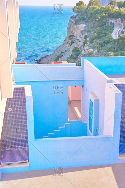 Serene landscape of quaint maze of walls built by blue sea in bright sunny day