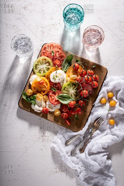 Overhead view of colorful caprese board