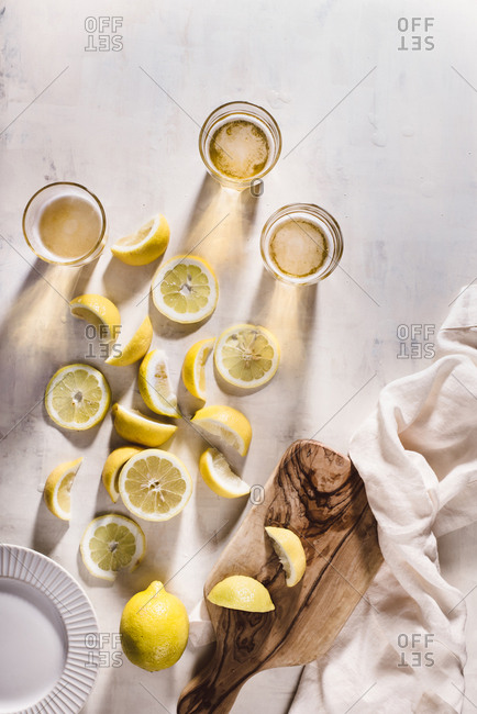 Beer and lemons on light background