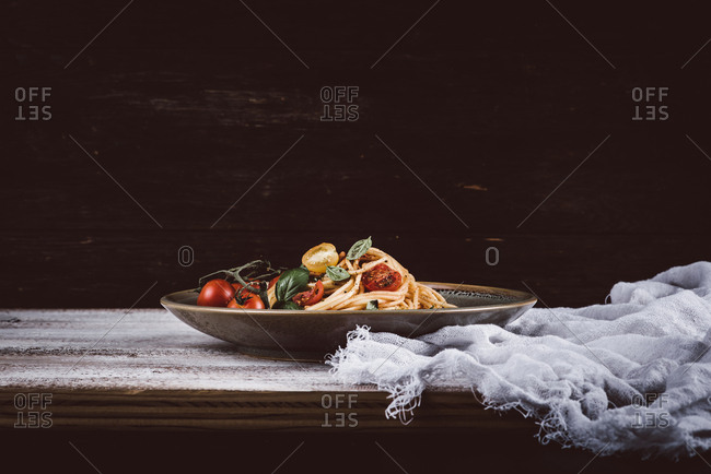 Large plate of pasta on rustic table