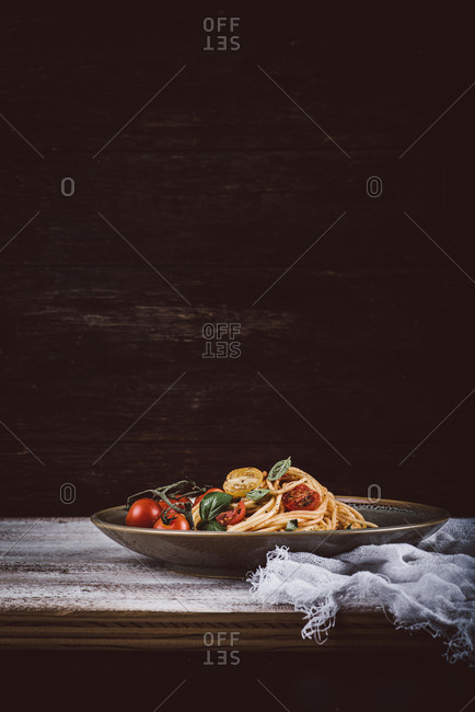 Big plate of pasta on rustic table