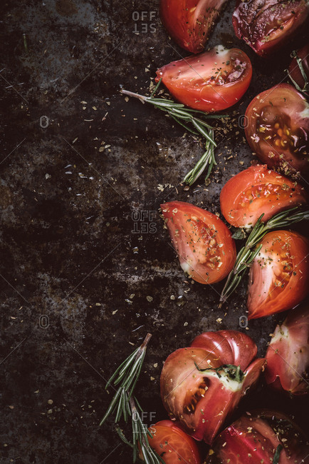 Roasted tomato dish with rosemary in progress