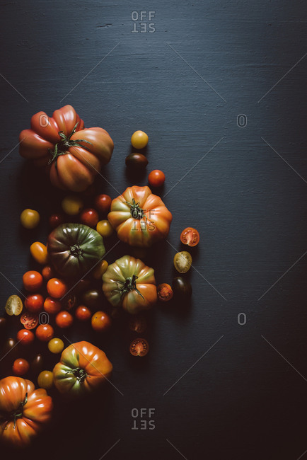 Variety of heirloom tomatoes on dark background