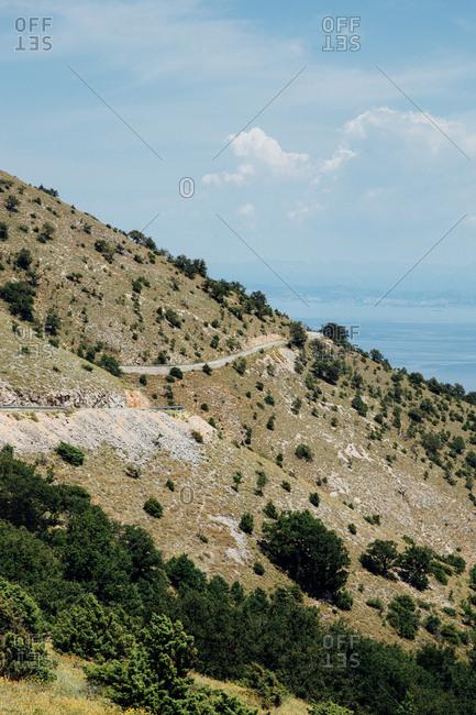 Winding road on hillside in Croatia