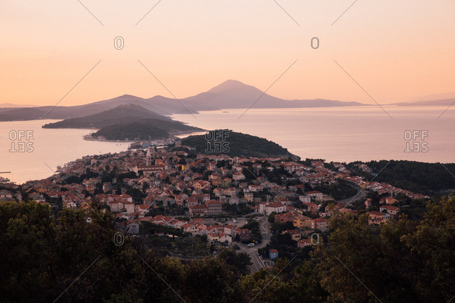 Sunset over Croatian hilltop village and the Adriatic Sea