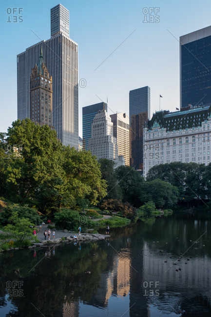 New York NY - USA - Jul 30 2019: The Pond at Summer Central Park view from Gapstow Bridge in New York City