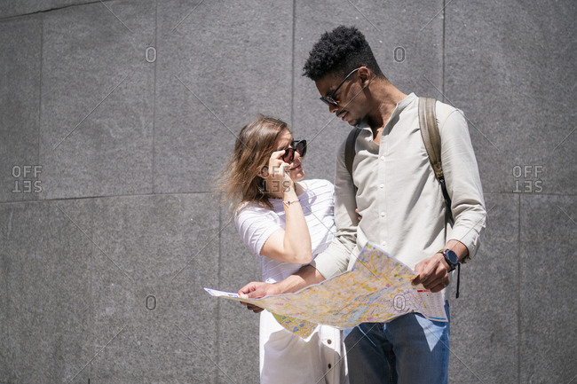 Young couple with city map- London- UK
