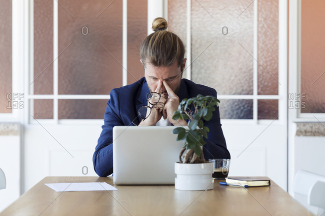 Focused businessman working at modern office