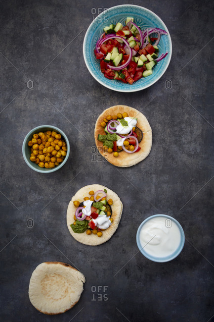 Ingredients for Sabich- pita bread with fresh vegetables- onions- yogurt and sauce