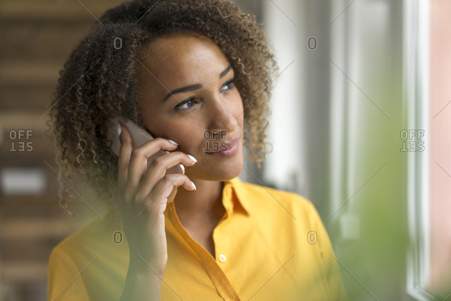 Portrait of young woman on the phone