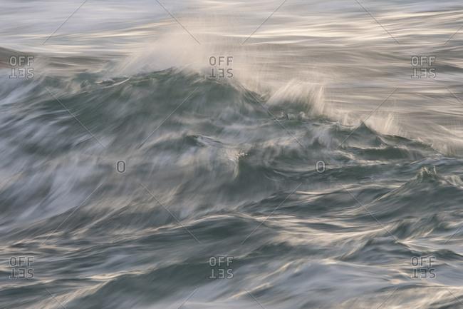 Waves splashing in body of water.