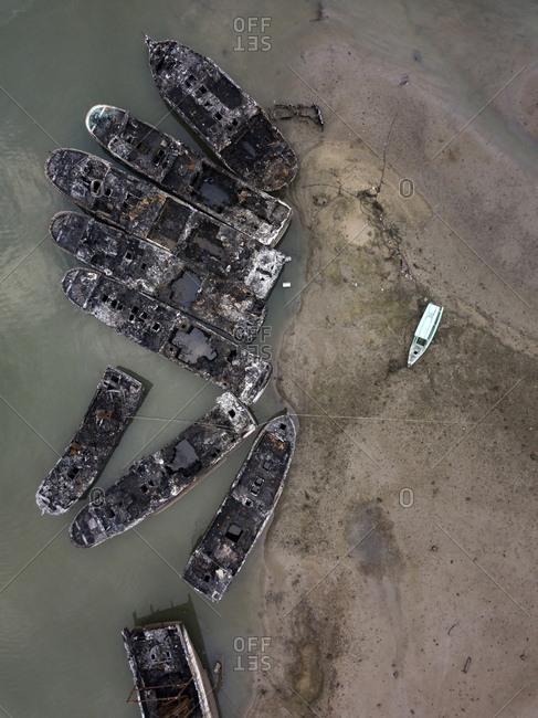 Abandoned boats at beach