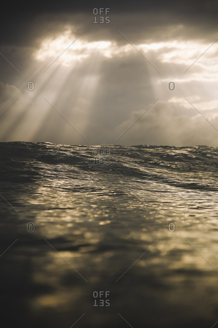 Sunset with light rays on the sea