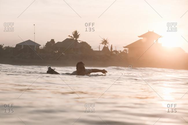 Young surfer man in ocean
