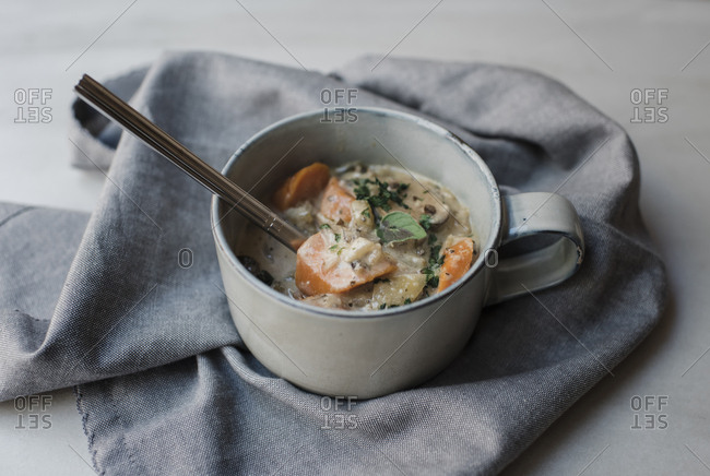 High angle view of soup served in bowl with fabric on table