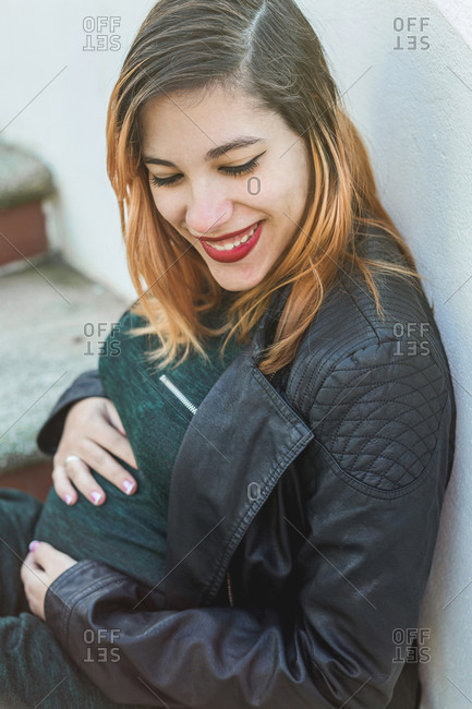 Portrait of a young and mother pregnant woman smiling