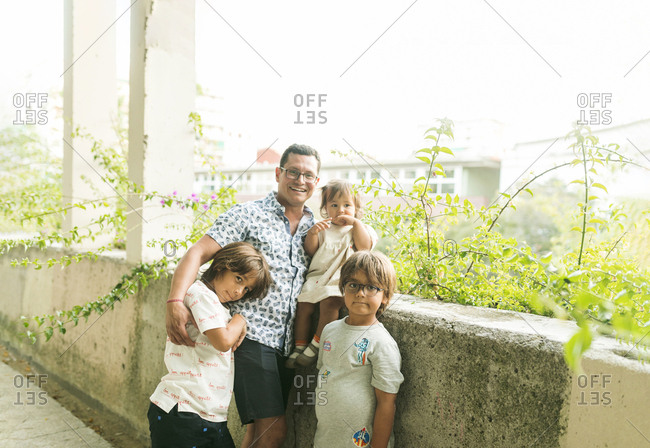 Portrait of father and kids in a urban park in barcelona