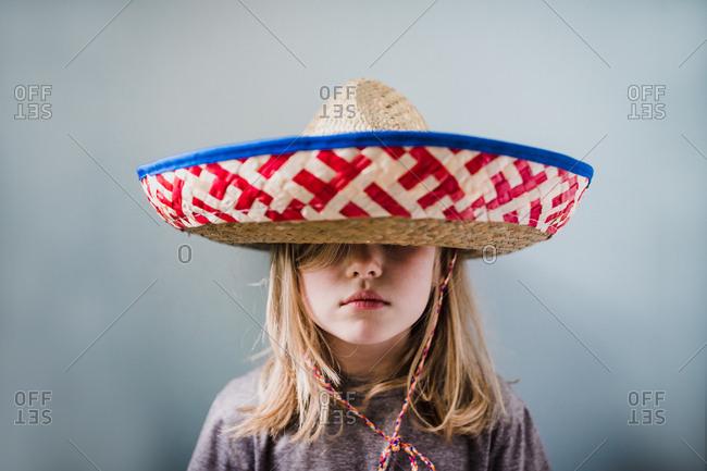 Blonde girl wearing a sombrero