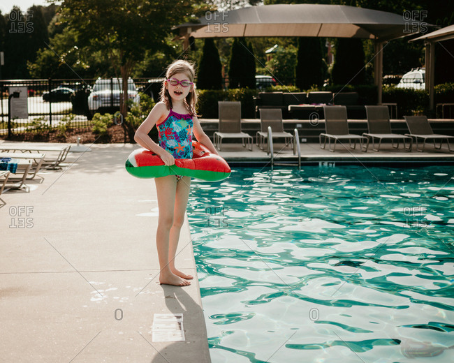 Little girl getting ready to jump into the pool