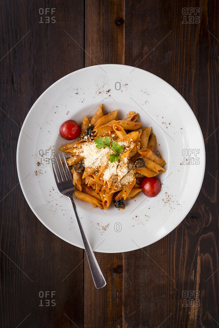 Tomato sauce pasta with olives and parmesan cheese