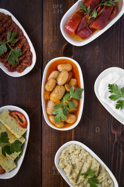 Variety of traditional Turkish mezes on the wooden surface