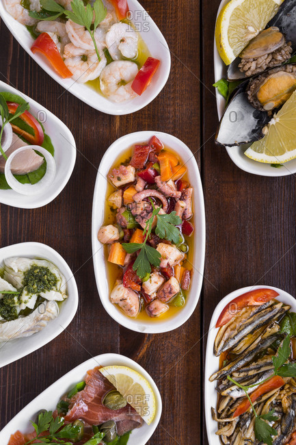 Traditional Turkish seafood mezes on the wooden surface