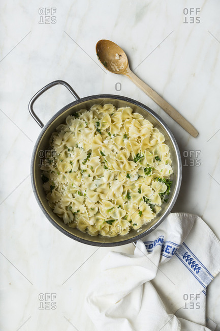 Boiled pasta with cheese and parsley