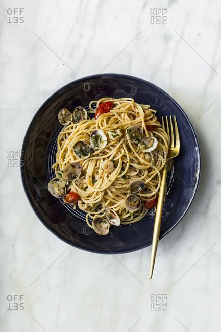 Seafood spaghetti on a marble surface